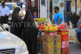 BAHRAIN, Manama Souk (souq), fruit stall and shoppers, BHR1098JPL
