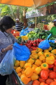 BAHRAIN, Noor El Ain, Garden Bazaar, Farmers Market, shopper at vegetable stall, BHR1158JPL