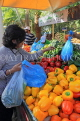 BAHRAIN, Noor El Ain, Garden Bazaar, Farmers Market, shopper at vegetable stall, BHR1159JPL