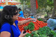 BAHRAIN, Noor El Ain, Garden Bazaar, Farmers Market, shopper at vegetable stall, BHR1248JPL