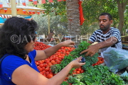BAHRAIN, Noor El Ain, Garden Bazaar, Farmers Market, shopper at vegetable stall, BHR1249JPL
