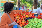 BAHRAIN, Noor El Ain, Garden Bazaar, Farmers Market, shopper at vegetable stall, BHR1788JPL