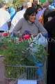 BAHRAIN, Noor El Ain, Garden Bazaar, Farmers Market, shopper with roses in trolly, BHR1152JPL