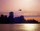 CANADA, British Columbia, VANCOUVER, Downtown skyline and helicopter, at dusk, CAN040JPL