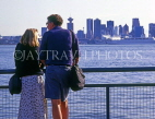 CANADA, British Columbia, VANCOUVER, Lonsdale Quay, couple looking towards Downtown, VAN936JPL