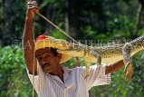CUBA, Guama, man demonstrating traditional method of trapping crocodile, CUB271JPL
