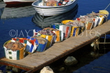CYPRUS, Akamas area, Latchi, fishing harbour, nets in bags, lined up on pier, CYP449JPL