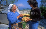 CYPRUS, Kritou, Tera, woman giving traditional Easter Sesame Bread, CYP111JPL