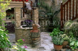 CYPRUS, Lefkara village, small courtyard with stone built well, CYP320JPL