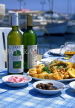CYPRUS, Paphos, Kato Paphos, cafe table, with Fish Meze and Cyprus wine, CYP405JPL