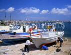 CYPRUS, Paphos, Kato Paphos, harbourfront boatyard, men painting boat, CYP226JPL