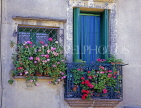 FRANCE, Languedoc-Roussillon, CAP DAGDE, AGDE, Old Town, wrought iron balconies with flowers, FR457JPL
