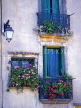 FRANCE, Languedoc-Roussillon, CAP DAGDE, AGDE, Old Town, wrought iron balconies with flowers, FR485JPL