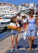 FRANCE, Languedoc-Roussillon, CAP DAGDE, girl carrying baguettes, FRA448JPL