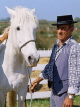 FRANCE, Languedoc-Roussillon, Camargue, cowboy with wild white horse, FRA421JPL