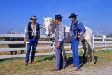 FRANCE, Languedoc-Roussillon, LA CAMARGUE, Cowboys with white horse, FRA610JPL