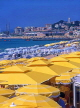 FRANCE, Provence, Cote d'Azure, CANNES, beach and parasols, Old Town in background, FRA224JPL