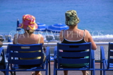 FRANCE, Provence, Cote d'Azure, NICE, Promenade des Anglais, two women on deckchairs, FRA291JPL