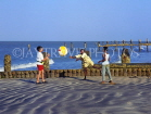 GAMBIA, Gambian children and tourist (boy) playing with ball on beach, GAM900JPL