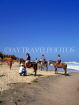 GAMBIA, Kotu Beach, tourists saddled up for horse riding, GAM1048JPL