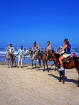 GAMBIA, Kotu Beach, tourists saddled up for horse riding, GAM841JPL