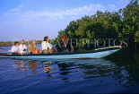 GAMBIA, River Gambia, tourists in dug out canoe (pirogues) on bird watching tour, GAM934JPL