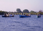 GAMBIA, River Gambia, tourists in dug out canoes (pirogues) on bird watching tour, GAM862JPL