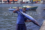 GRENADA, St George's, fisherman with Barracuda fish, GRE422JPL