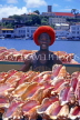 GRENADA, St George's, vendor with Conch shells, GRE434JPL