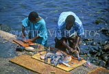 GRENADA, fishermen cleaning fish, GRE418JPL