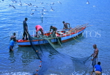 GRENADA, fishermen in boat, sorting out nets, GRE356JPL