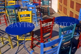 Greek Islands, ANAPHI, Aylos Nikolaos, brightly painted tables and chairs in cafe, GIS709JPL