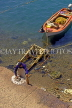 Greek Islands, KOS, Kos Town, fisherman cleaning Octopus, GIS1238JPL