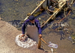 Greek Islands, KOS, Kos Town, fisherman cleaning Octopus, GIS198JPL
