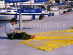 Greek Islands, KOS, Kos Town, fisherman mending net, harbourfront, GIS1032JPL