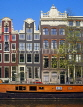 HOLLAND, Amsterdam, typical gabled architecture and houseboat, HOL688JPL