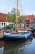 HOLLAND, Edam, old town, canalside and moored boat, HOL815JPL