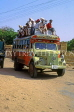 INDIA, Rajasthan, JAISALMER, crowded bus with passengers on roof, IND619JPL