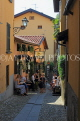 ITALY, Lombardy, Lake Como, BELLAGIO, narrow street and restaurant, ITL2190JPL