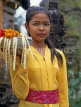 Indonesia, BALI, village girl at temple, with flower offerings, BAL545JPL