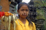 Indonesia, BALI, village girl at temple, with flower offerings, BAL761JPL