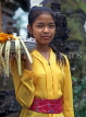 Indonesia, BALI, village girl at temple, with flower orrferings, BAL547JPL