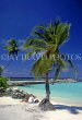 MALDIVE ISLANDS, beach and pier, with two tourists and coconut tree, MAL679JPL