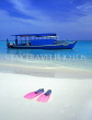 MALDIVE ISLANDS, beach with pair of flippers and Dhoni (fishing boat), MAL505JPL