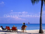 MALDIVE ISLANDS, deckchairs and tourists on beach, MAL699JPL