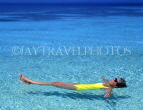 MALDIVE ISLANDS, holidaymaker floating in shallow water, MAL123JPL