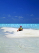MALDIVE ISLANDS, holidaymaker sunbathing on patch of sand, shallow water, MAL255JPL