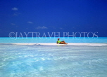 MALDIVE ISLANDS, holidaymaker sunbathing on strip of sand, shallow water, MAL253JPL