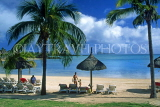 MAURITIUS, North East Coast, beach by Legends Hotel, coconut palms and sunshades, MRU351JPL