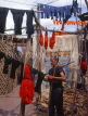 MOROCCO, Marrakesh, Medina (old town), man drying coloured wool, MOR308JPL